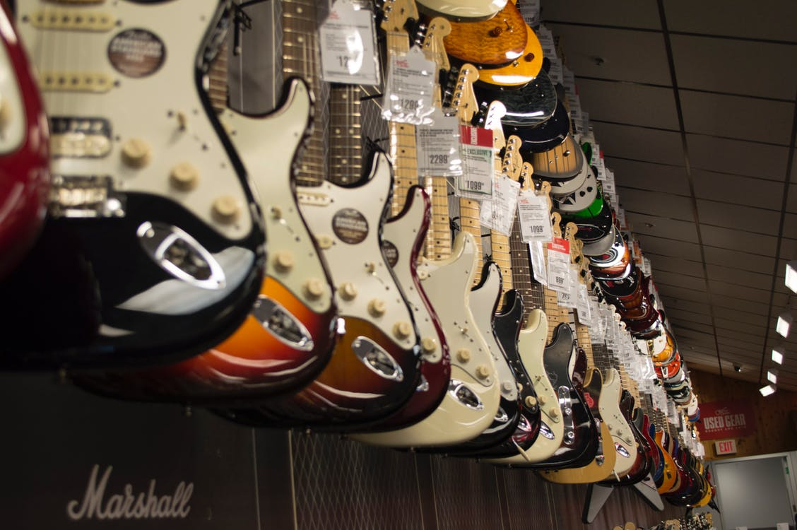 Electric Guitars Hanging in Store
