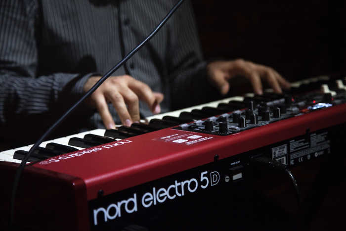 Man Playing Nord Digital Piano